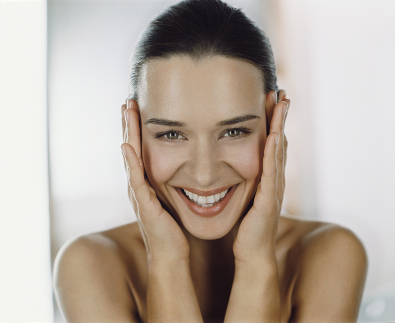 Female Hands on Face Smiling to Camera. Model Image. JPEG. MODEL USAGE RIGHTS: This image can ONLY be used in conjunction with the ELEMIS brand. It can ONLY be used for PR, In-Store (Spas, Stockists), Limited Printed Materials, Trade Advertising and Online. It CANNOT be used for any NATIONAL ADVERTISING CAMPAIGNS. Expires: October 2016.